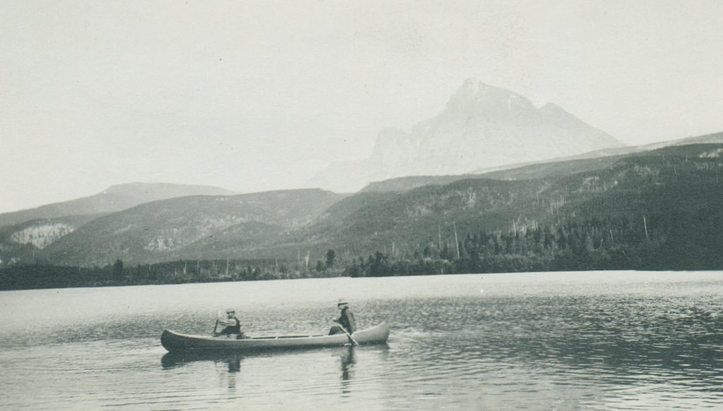 Two people on a canoe in a lake